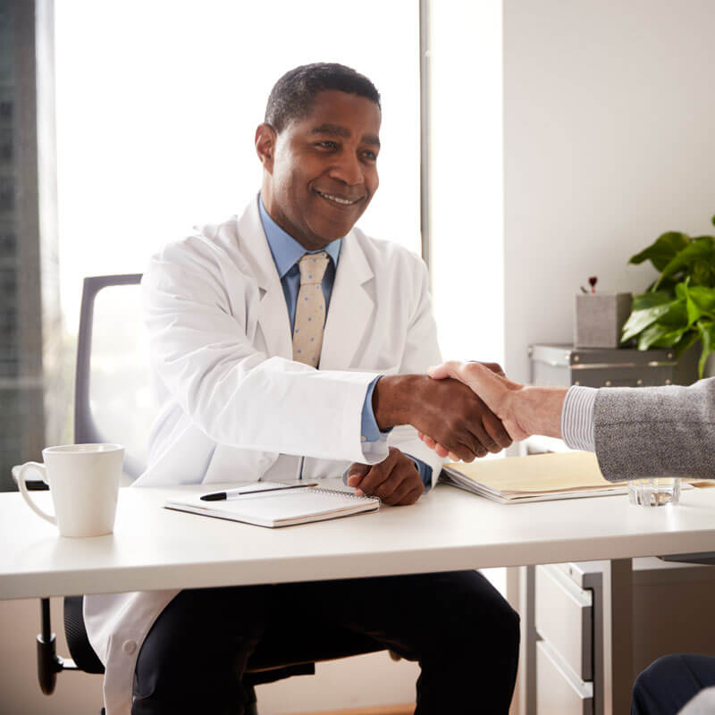 senior-man-having-consultation-with-male-doctor-KAS5V93